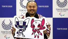 The designer of winning mascots Ryo Taniguchi poses for a photograph during a news conference after