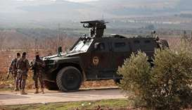 Members of Turkish police special forces are seen near Mount Barsaya in Qastal village, Azaz