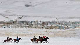 Mounted Kyrgyz riders play the traditional central Asian sport Kok-boru