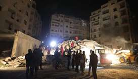 Syrian emergency services search for members of four families reportedly stuck under the rubble of a
