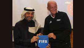 Former Italian referee Pierluigi Collina and FIFA Chairman of the Referees Committee (R) poses with
