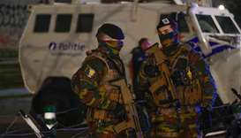"""Belgian soldiers stand guard at the entrance of the """"Palais de Justice"""" courthouse in Brussels"""