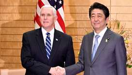 US Vice President Mike Pence (L) shakes hands with Japan's Prime Minister Shinzo Abe