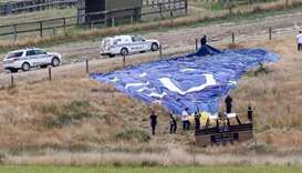Police inspect a hot air balloon after it crashed during a dawn tour at Dixons Creek, some 60 kilome