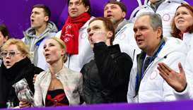 Russia's Evgenia Tarasova (2nd L) and Russia's Vladimir Morozov (2nd R) react after competing in the
