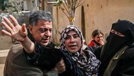 Relatives of of slain Palestinian policeman Major Abdul Hamid Attallah al-Ekar, who suffocated to de
