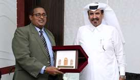 Qatar Chamber first vice-chairman Mohamed bin Towar al-Kuwari receiving a token of recognition from