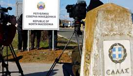 North Macedonia puts up new name on border with Greece