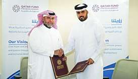 Director General of Qatar Fund for Development Khalifa bin Jassim al-Kuwari and CEO of Qatar Charity