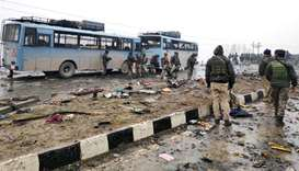 Indian soldiers examine the debris after an explosion in Lethpora in south Kashmir's Pulwama distric