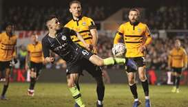 Manchester City's Phil Foden (left) and Newport's Mickey Demetriou