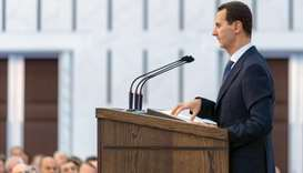 President Bashar al-Assad delivering a speech at a meeting for the heads of local councils in the ca