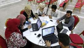 "Iraqi youths work at ""The Station"", Baghdad's incubator for would-be entrepreneurs in Baghdad"