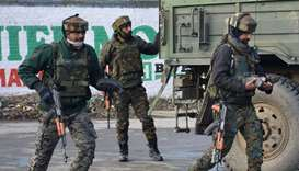 Indian Army soldiers arrive near the site of a gun battle between suspected militants and Indian sec