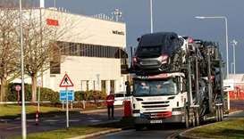 A lorry with car carrier trailer leaves the Honda car plant in Swindon, Britain