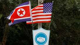 North Korean and US flags