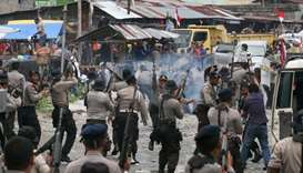 Hundreds of students flee violence in Indonesia's Papua