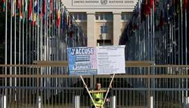 A man wearing a yellow vest demonstrates outside the United Nations ahead of the Human Rights Counci