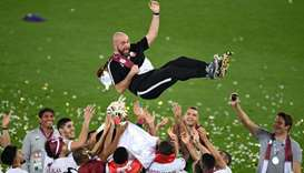 Qatar's coach Felix Sanchez is thrown in the air as his team celebrates their win in the 2019 AFC As