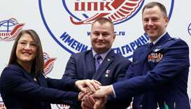 ISS crew members Aleksey Ovchinin of Russia and Nick Hague of the US, along with Christina Koch of t