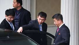 Kim Hyok Chol, (R), North Korea's special representative for U.S., affairs leaves the Government Gue