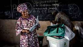 An electoral commission official reads an electoral manual in Yola, in Nigeria