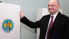 Moldovans vote for new government amid talk of protests and poisoning
