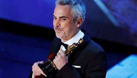 """Alfonso Cuaron accepts the Foreign Language Film award for """"Roma""""."""