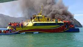 Malaysian passenger ferry with 58 people onboard caught fire