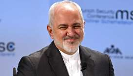 Iran's Foreign Minister Mohammad Javad Zarif smiles during the annual Munich Security Conference in