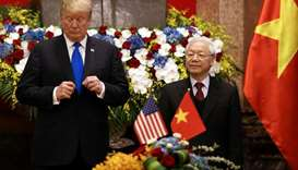 Vietnamese President Nguyen Phu Trong and Trump attend a signing ceremony at the Presidential Palace