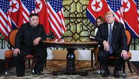 US President Donald Trump (R) and North Korea's leader Kim Jong Un hold a meeting during the second
