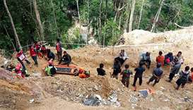 Rescuers preparing to enter in a collapsed illegal gold mine in the Bolaang Mongondow region of Nort