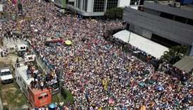 Opposition supporters take part in a rally against Venezuelan President Nicolas Maduro's government