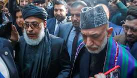 Afghan former President Hamid Karzai and Head of Political Office of the Taliban Sher Mohammad Abbas