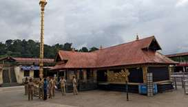 Police stand inside the premises of the Sabarimala temple in India