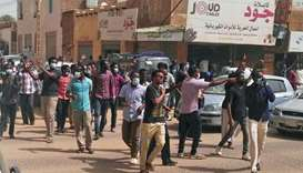 Sudanese protesters take part in an anti-government demonstration in Khartoum