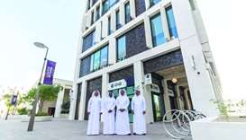 QNB executives in front of the bank's building ocated adjacent to MDD's underpass to Souq Waqif.