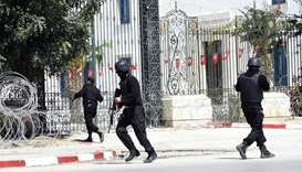 In this file photo taken on March 18, 2015, Tunisian security forces secure the area after gunmen at