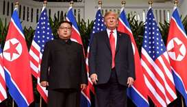 US President Donald Trump (R) posing with North Korea's leader Kim Jong Un (L)