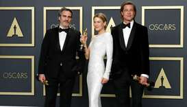 Best Actor winner Joaquin Phoenix, Best Actress Renee Zellweger and Best Supporting Actor Brad Pitt