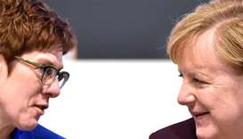 German Chancellor Angela Merkel (right) talks to Annegret Kramp-Karrenbauer