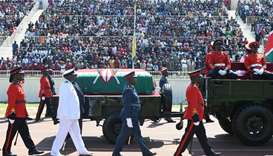 Military officers escort a gun carriage carrying the coffin of late former Kenya President, Daniel A