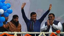 Delhi Chief Minister and leader of Aam Aadmi Party (AAP) Arvind Kejriwal waves to his supporters dur