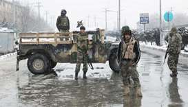 Security forces keep watch near a site in Kabul, Afghanistan