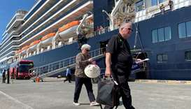 Passengers leave the cruise ship MS Westerdam in the Cambodian port of Sihanoukville, February 15, 2