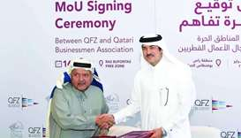 Sheikh Faisal and al-Sayed shaking hands after signing the MoU.