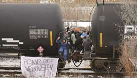 Supporters of the indigenous Wet'suwet'en Nation occupy railway tracks as part of a protest against