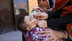 A boy receives polio vaccine drops during an anti-polio campaign yesterday in Peshawar, Pakistan