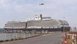 A helicopter takes off next to the Westerdam cruise ship in Sihanoukville yesterday, as authorities